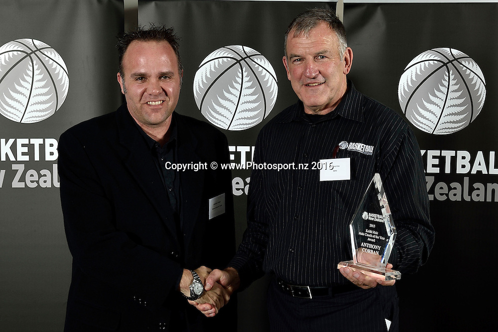 Anthony Corban (L) receives the Keith Mair  Male Coach of the Year award from Iain Potter during the Basketball New Zealand awards evening at the Mercure Hotel in Wellington on Friday the 20th of May 2016. Copyright Photo by Marty Melville / www.Photosport.nz