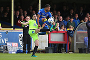 AFC Wimbledon midfielder Tom Soares (14) battles for possession with Peterborough United defender Andrew Hughes (3) during the EFL Sky Bet League 1 match between AFC Wimbledon and Peterborough United at the Cherry Red Records Stadium, Kingston, England on 17 April 2017. Photo by Matthew Redman.