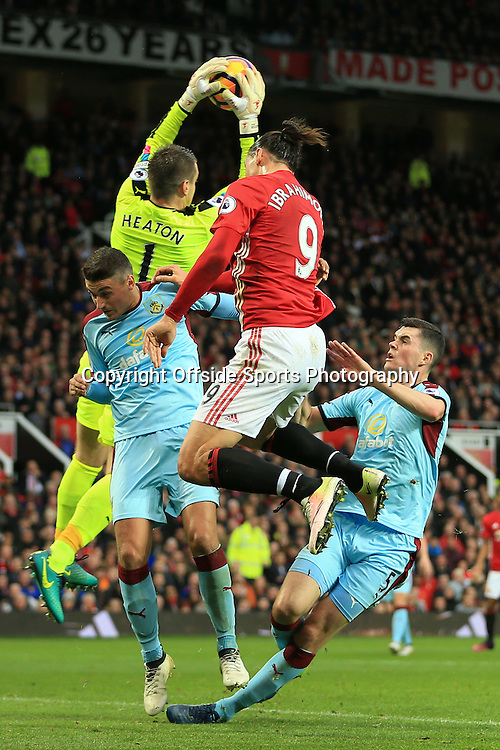 29th October 2016 - Premier League - Manchester United v Burnley - Burnley goalkeeper Thomas Heaton catches the ball ahead of teammates Matthew Lowton of Burnley (L) and Michael Keane of Burnley as well as Zlatan Ibrahimovic of Man Utd - Photo: Simon Stacpoole / Offside.