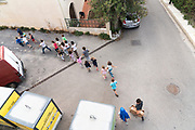 school children group walking in the street with teachers, rural France