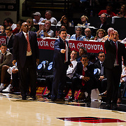 22 December 2018: San Diego State Aztecs coaches (r-l) Brain Dutcher, David Velasquez and Rod Palmer yell in a play during the fist half. The Aztecs beat the Cougars 90-81 Satruday afternoon at Viejas Arena.