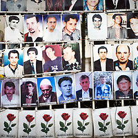 "Pristina, Kosovo 17 February 2011<br /> A white metal fence is lined with portraits of missing people who had not been seen since 1998/99, the years of the Kosovo War, in centre Pristina.<br /> After the Kosovo War and the 1999 NATO bombing of Yugoslavia, the territory of Kosovo came under the interim administration of the United Nations Mission in Kosovo (UNMIK), and most of those roles were assumed by the European Union Rule of Law Mission in Kosovo (EULEX) in December 2008. <br /> In February 2008 individual members of the Assembly of Kosovo declared Kosovo's independence as the Republic of Kosovo. Its independence is recognised by 75 UN member states. <br /> On 8 October 2008, upon request of Serbia, the UN General Assembly adopted a resolution asking the International Court of Justice for an advisory opinion on the issue of Kosovo's declaration of independence.<br /> On 22 July 2010, the ICJ ruled that Kosovo's declaration of independence did not violate international law, which its president said contains no ""prohibitions on declarations of independence"".<br /> Photo: Ezequiel Scagnetti"