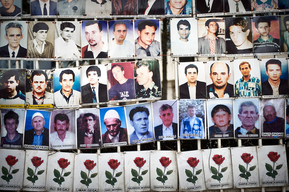 Pristina, Kosovo 17 February 2011<br /> A white metal fence is lined with portraits of missing people who had not been seen since 1998/99, the years of the Kosovo War, in centre Pristina.<br /> After the Kosovo War and the 1999 NATO bombing of Yugoslavia, the territory of Kosovo came under the interim administration of the United Nations Mission in Kosovo (UNMIK), and most of those roles were assumed by the European Union Rule of Law Mission in Kosovo (EULEX) in December 2008. <br /> In February 2008 individual members of the Assembly of Kosovo declared Kosovo's independence as the Republic of Kosovo. Its independence is recognised by 75 UN member states. <br /> On 8 October 2008, upon request of Serbia, the UN General Assembly adopted a resolution asking the International Court of Justice for an advisory opinion on the issue of Kosovo's declaration of independence.<br /> On 22 July 2010, the ICJ ruled that Kosovo's declaration of independence did not violate international law, which its president said contains no &quot;prohibitions on declarations of independence&quot;.<br /> Photo: Ezequiel Scagnetti