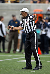 BERKELEY, CA - SEPTEMBER 12:  NCAA referee Michael Mothershed stands on the field during the second quarter between the California Golden Bears and the San Diego State Aztecs at California Memorial Stadium on September 12, 2015 in Berkeley, California. The California Golden Bears defeated the San Diego State Aztecs 35-7. (Photo by Jason O. Watson/Getty Images) *** Local Caption *** Michael Mothershed