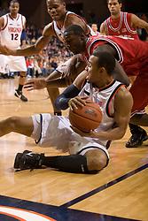 Virginia guard Calvin Baker (4) grabs a loose ball from North Carolina State guard Courtney Fells (4).  The Virginia Cavaliers men's basketball team defeated the North Carolina State Wolfpack 78-60 at the John Paul Jones Arena in Charlottesville, VA on February 24, 2008.
