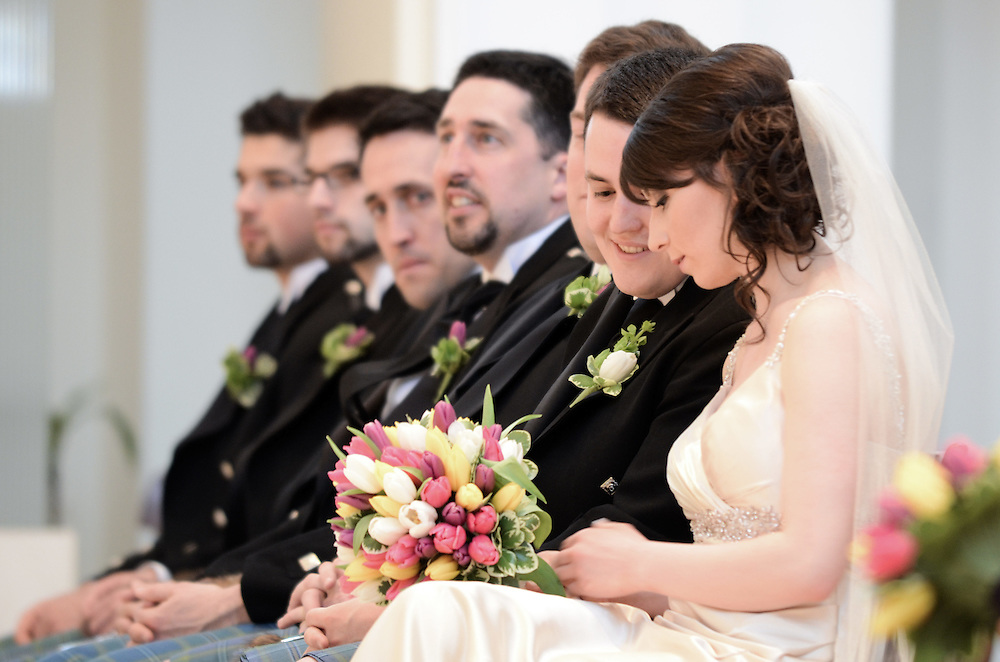 Kathleen, Brendan, and the groomsmen during the ceremony, Madonna della Strada Chapel, Loyola University Chicago