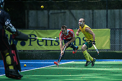 England's Nick Catlin crosses the ball. England v Australia, Bisham Abbey, Marlow, UK on 25 May 2014. Photo: Simon Parker