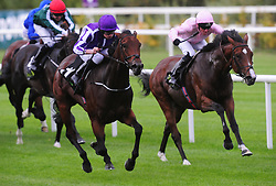 Horse I Can Fly & Ryan Moore (left) win the Group 2 Clipper Logistics Boomerang Stakes from Stable Companion Kenya & Seamus Heffernan (right) during day one of the 2018 Longines Irish Champions Weekend at Leopardstown Racecourse, Dublin.