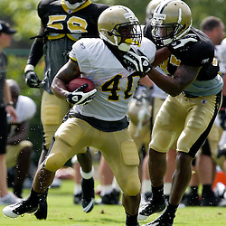 01 August 2009: New Orleans Saints running back Herb Donaldson (40) breaks away from the tackle attempt of safety Chip Vaughn (37) during New Orleans Saints training camp at the team's practice facility in Metairie, Louisiana.