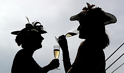 Racegoers enjoy a drink during ladies day of the 2018 Investec Derby Festival at Epsom Downs Racecourse, Epsom.