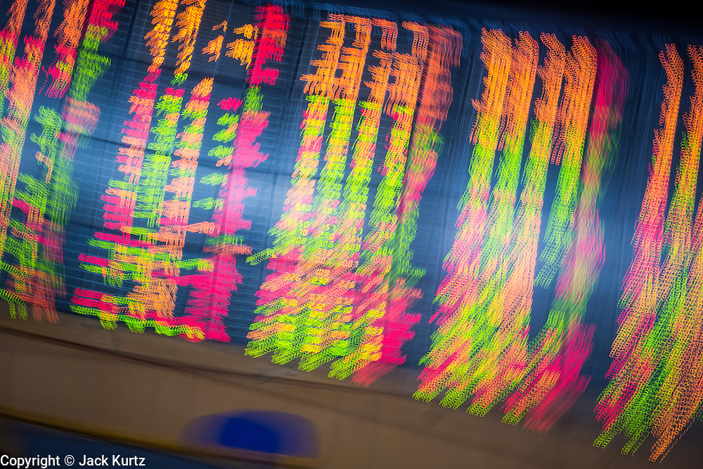 02 SEPTEMBER 2013 - BANGKOK, THAILAND:  The stock ticker at Asia Plus Securities headquarters in central Bangkok. The Thai stock market has declined more than 20% from its 2013 high as data as Thailand entered a recession in the second quarter. The loss of value in the Stock Exchange of Thailand (SET) is the greatest sell off since the end of the Asian financial crisis in 1998. Foreign investors have sold more than $1 billion of local shares this month amid signs of slowing regional economic growth and speculation that the U.S. Federal Reserve will soon cut its stimulus.     PHOTO BY JACK KURTZ