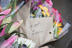 © Licensed to London News Pictures.20/03/2017.London, UK. A floral tribute that says 'with sympathy from #30 Wilberforce' is placed outside the house where one baby was found dead and another seriously injured in Finsbury Park, East London. Bidhya Sagar Das, 33, believed to be the children's father, has been arrested. Photo credit: Peter Macdiarmid/LNP