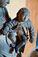 Statue of a mother holding a child at Chateauneuf-en-Auxois, France.