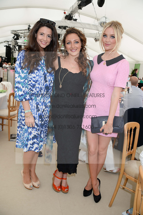 Left to right, SHIRLEY LEIGH WOOD-OAKES, NATASHA CORRETT and LAURA WHITMORE at the Boujis hospitality at the Audi International Polo at Guards Polo Windsor Great Park, Egham, Surrey on 28th July 2013.