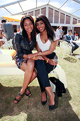 Left to right, NAOMIE HARRIS and LOUISE PIERRE at the Veuve Clicquot Gold Cup polo final held at Cowdray Park, Midhurst, West Sussex on 18th July 2010.