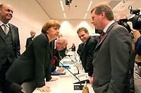 18 DEC 2003, BERLIN/GERMANY:<br /> Laurenz Meyer, CDU Generalsekretaer, Angela Merkel, CDU Bundesvorsitzende, Volker Kauder, CDU, 1. Parl. Geschaeftsfuehrer CDU/CSU BT-Fraktion, Dieter Althaus, CDU, Ministerpraesident Thueringen, und Christian Wulff, CDU, Ministerpraesident Niedersachsen, (v.L.n.R.), im Gespraech, vor Beginn der CDU/CSU Fraktionssitzung, Deutscher Bundestag<br /> IMAGE: 20031218-02-009<br /> KEYWORDS: Sitzung, Gespräch, Ministerpräsident