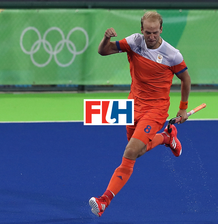 RIO DE JANEIRO, BRAZIL - AUGUST 14:  Billy Bakker of the Netherlands celebrates after scoring the first goal during the Men's hockey quarter final match between the Netherlands and Australia on Day 9 of the Rio 2016 Olympic Games at the Olympic Hockey Centre on August 14, 2016 in Rio de Janeiro, Brazil.  (Photo by David Rogers/Getty Images)