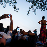 July 17, 2012 - New York, NY : Concertgoers stretch out on, and around, the great lawn to hear the New York Philharmonic perform in Central Park on Monday evening. CREDIT: Karsten Moran for The New York Times