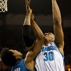February 1, 2011; New Orleans, LA, USA; New Orleans Hornets power forward David West (30) shoots over Washington Wizards shooting guard Nick Young (1) during the second quarter at the New Orleans Arena.   Mandatory Credit: Derick E. Hingle