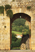 Archway overlooking the Tuscan countryside in Italy.<br /> <br /> Available sizes:<br /> 12&quot; x 18&quot; print <br /> 12&quot; x 18&quot; gallery wrap<br /> See Pricing page for more information.