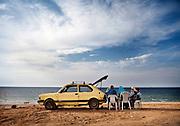 A family in Gaza City enjoys a picnic on the beach.