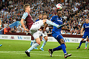 Aston Villa defender Bjorn Engels (22) trys to get in across under pressure from Everton forward Dominic Calvert-Lewin (9) during the Premier League match between Aston Villa and Everton at Villa Park, Birmingham, England on 23 August 2019.