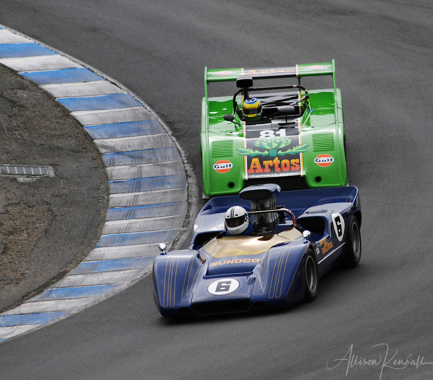 Close competition between two racecars in the corkscrew at Laguna Seca, Monterey