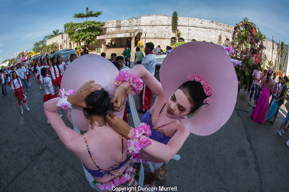 Dancers preparing for the Balayong Festival street dancing competition. The festival at the beginning of March commemorates the founding anniversary of the City of Puerto Princesa, Palawan, highlighted by balayong tree-planting, street dancing and a colourful floral parade depicting the Palawan cherry blossoms from which the festival derives its name. The Palawan cherry is one of the most popular flowering trees in Palawan and known by the locals as the Balayong, a beautiful tree that when it is in full bloom resembles the cherry blossoms of Japan.