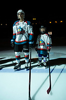 KELOWNA, CANADA - JANUARY 30:  Matt Barberis #22 of the Kelowna Rockets stands on the blue line at the start of the game with Xander Griffiths the Pepsi Player against the Seattle Thunderbirds on January 30, 2019 at Prospera Place in Kelowna, British Columbia, Canada.  (Photo by Marissa Baecker/Shoot the Breeze)