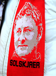 A general view of a Manchester United caretaker manager Ole Gunnar Solskjaer scarf on a fan prior to the Premier League match at the King Power Stadium, Leicester.