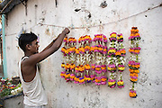 A man selling flowers in the street, Bombay (Mumbai), India