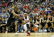 Ben Emelogu (15) of South Grand Prairie drives to the basket against C.J. Siples (2) of Cibolo Steele during the UIL Conference 5A semifinals at the Frank Erwin Center in Austin on Friday, March 8, 2013. (Cooper Neill/The Dallas Morning News)
