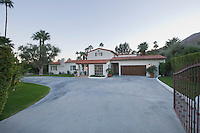 Open gate and driveway of Palm Springs home