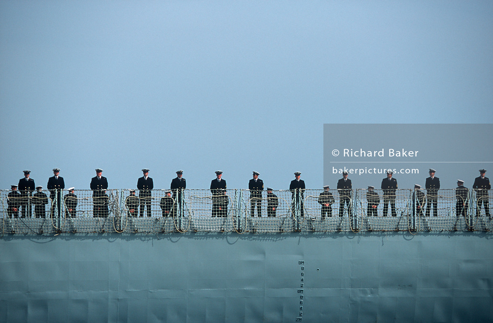 Royal Navy sailors line the deck of the frigate HMS Monmouth (F235), on 23rd August 2001, near Portsmouth, England. (Photo by Richard Baker / In Pictures via Getty Images)