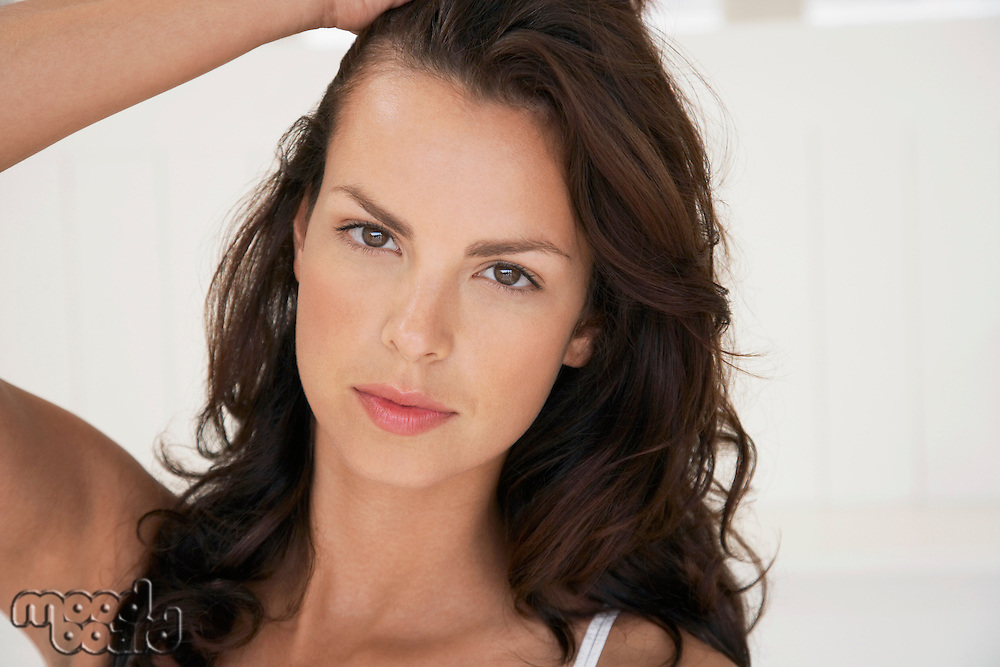 Woman with long brown hair portrait head and shoulders