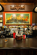 Norman Rockwell's painting The Dover Coach, a gift from Rockwell, hangs over the bar at the Society of Ilustrators.