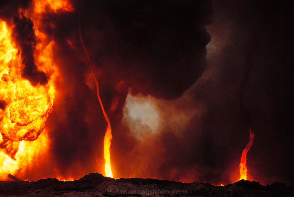 The burning Magwa oil fields near Ahmadi in Kuwait right after the end of the Gulf War in May of 1991. Tornados of fire are seen spinning off a burning well. More than 700 wells were set ablaze by retreating Iraqi troops creating the largest man-made environmental disaster in history.