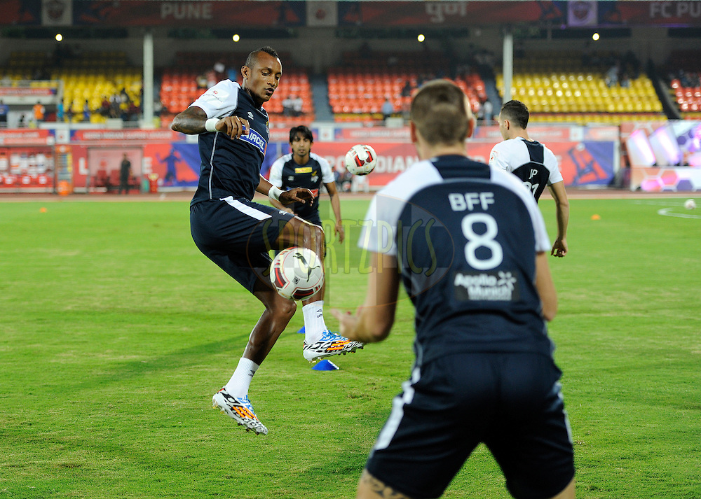 Fikru Tefera Lemessa of Atletico de Kolkata during a warm up session before the start of the match 44 of the Hero Indian Super League between FC Pune City and Atletico de Kolkata FC held at the Shree Shiv Chhatrapati Sports Complex Stadium, Pune, India on the 29th November 2014.<br /> <br /> Photo by:  Pal Pillai/ ISL/ SPORTZPICS