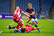 Duhan van der Merwe (#11) of Edinburgh Rugby runs at Dan Jones (#10) of Scarlets and Johnny McNicholl (#15) of Scarlets during the Guinness Pro 14 2019_20 match between Edinburgh Rugby and Scarlets at BT Murrayfield Stadium, Edinburgh, Scotland on 26 October 2019.