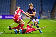 Duhan van der Merwe (#11) of Edinburgh Rugby runs at Dan Jones (#10) of Scarlets and Johnny McNicholl (#15) of Scarlets during the Guinness Pro 14 2019_20 match between Edinburgh Rugby and Scarlets at BT Murrayfield Stadium, Edinburgh, Scotland on 26 October 2019.