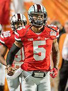 January 3, 2014 - Miami Gardens, Florida, U.S: Ohio State Buckeyes quarterback Braxton Miller (5) enters the field to warm up before the Discover Orange Bowl game between the Clemson Tigers and the Ohio State Buckeyes at Sun Life Stadium in Miami Gardens, Fl