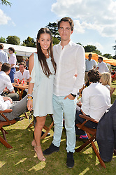 VISCOUNT ERLEIGH and OLIVIA CALLAGHAN at the Summer Solstice Party during the Boodles Tennis event hosted by Beulah London and Taylor Morris at Stoke Park, Park Road, Stoke Poges, Buckinghamshire on 21st June 2014.