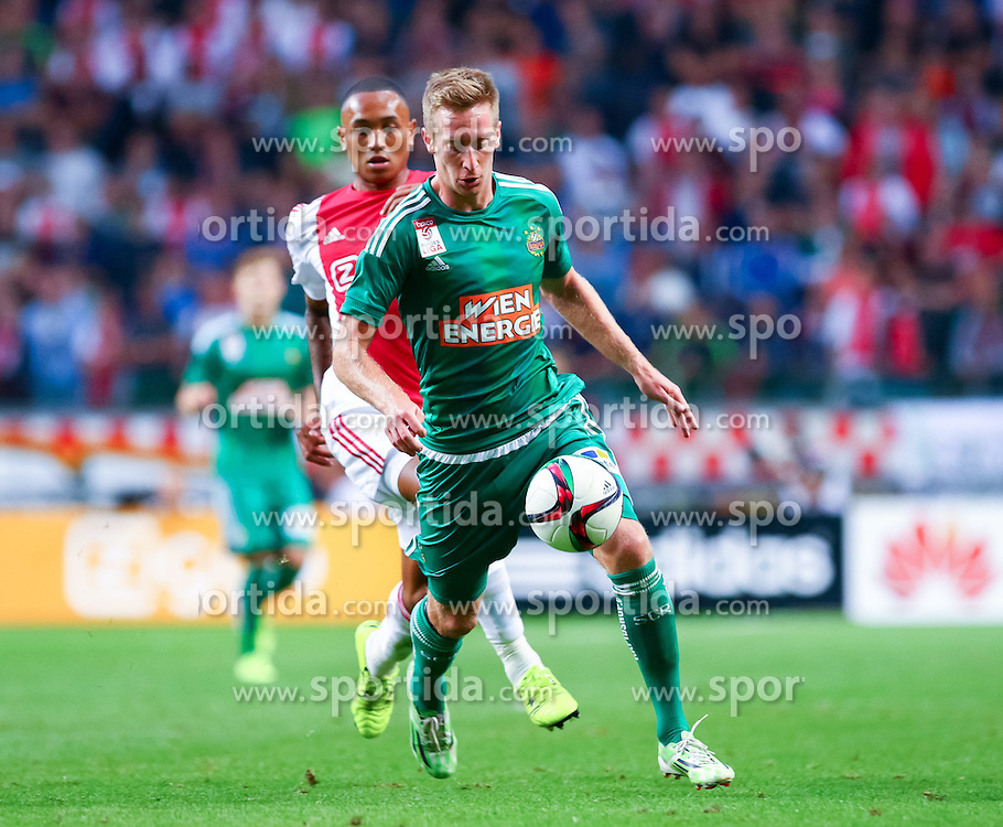 04.08.2015, Amsterdam Arena, Amsterdam, NLD, UEFA CL, Ajax Amsterdam vs SK Rapid Wien, Qualifikation, 3. Runde, Rückspiel, im Bild Kenny Tete (Ajax Amsterdam), Robert Beric (SK Rapid Wien)// during the UEFA Champions League Qualifier 3rd round, 2nd Leg Match between Ajax Amsterdam and SK Rapid Wien at the Amsterdam Arena in Amsterdam, Netherlands on 2015/08/04. EXPA Pictures © 2015, PhotoCredit: EXPA/ Sebastian Pucher