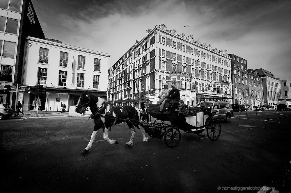 Tourists enjoy a horse and cart ride in Dublin City