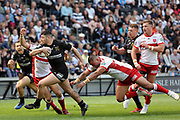 Hull FC second row forward Mark Minichiello (12) burst through during the Betfred Super League match between Hull FC and Hull Kingston Rovers at Kingston Communications Stadium, Hull, United Kingdom on 19 April 2019.
