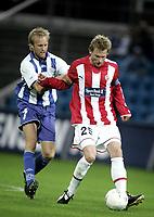 Fotball<br /> Danmark<br /> Foto: Polfoto/Digitalsport<br /> NORWAY ONLY<br /> <br /> Anders M. Christensen og Ole Martin Aarst i nærkamp, da Esbjerg torsdag mødte norske Tromsø i 2. runde af kvalifikationen til UEFA-cupen.
