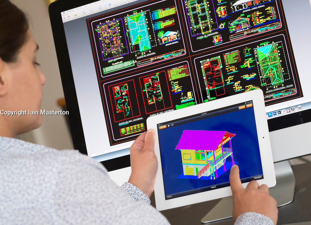 Architect using iPad CAD Computer Aided design application to model 3D layout design of new house