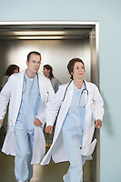 Two doctors running out of elevator
