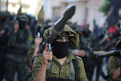 October 4, 2018 - Gaza - Palestinian masked members of Al-Quds Brigades, the military wing of the Islamic Jihad group, march with their weapons to show loyalty for the Iranian-backed Palestinian movement's newly elected leader Ziad al-Nakhalah during a rally along the streets of Gaza. (Credit Image: © Majdi Fathi/NurPhoto/ZUMA Press)