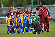 Croydon Athletic have their pre match huddle as the mascots cover their ears during the Southern Counties East match between AFC Croydon Athletic and Hollands & Blair at the Mayfield Stadium, Croydon, United Kingdom on 10 October 2015. Photo by Mark Davies.